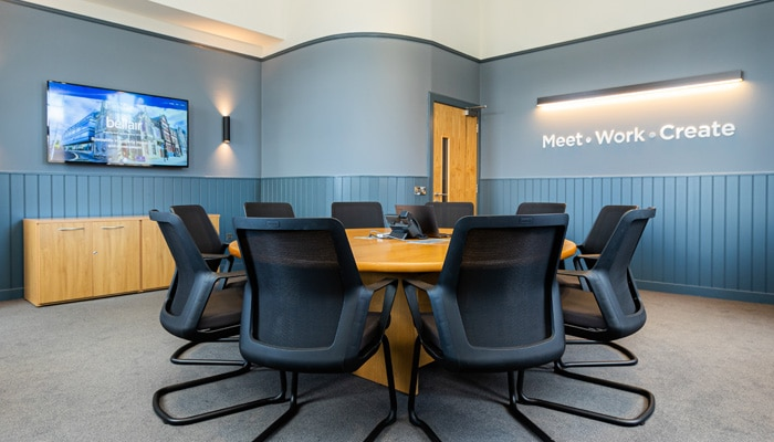 The prestigious first floor boardroom at Falkirk Business Hub seats ten around a circular table. Fully modernised this room is located within the original listed building and boasts traditional features and corner turret.